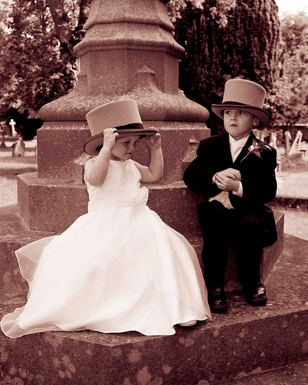 Flower girl and page boy wearing top hats - Picture by Photography by Riddell