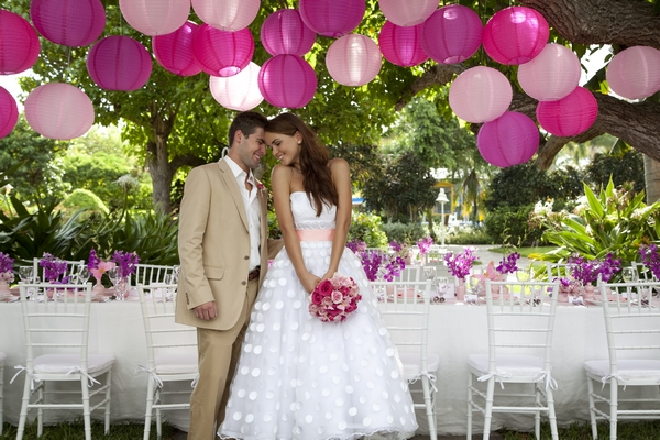Bride and groom with pink balloons