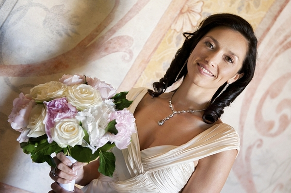 Bride holding bridal bouquet - Picture by Gill Maheu Photography
