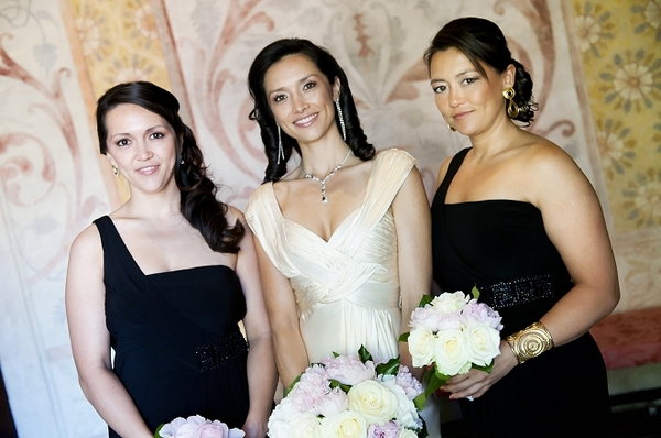 Bride with bridesmaids wearing black dresses