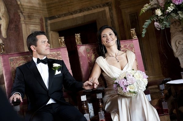 Bride and groom sitting in chairs at wedding ceremony - Picture by Gill Maheu Photography