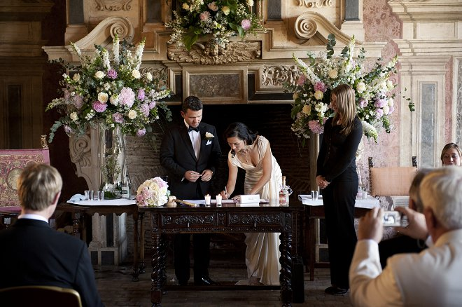 Bride and groom signing the register - Picture by Gill Maheu Photography