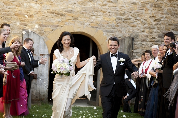 Bride and groom leaving wedding ceremony - Picture by Gill Maheu Photography