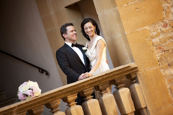 Bride and groom on balcony of French chateau - Picture by Gill Maheu Photography