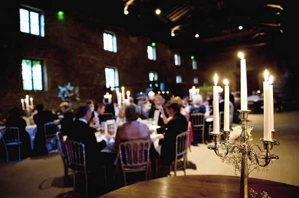 Wedding breakfast with candles in foreground - Picture by Gill Maheu Photography
